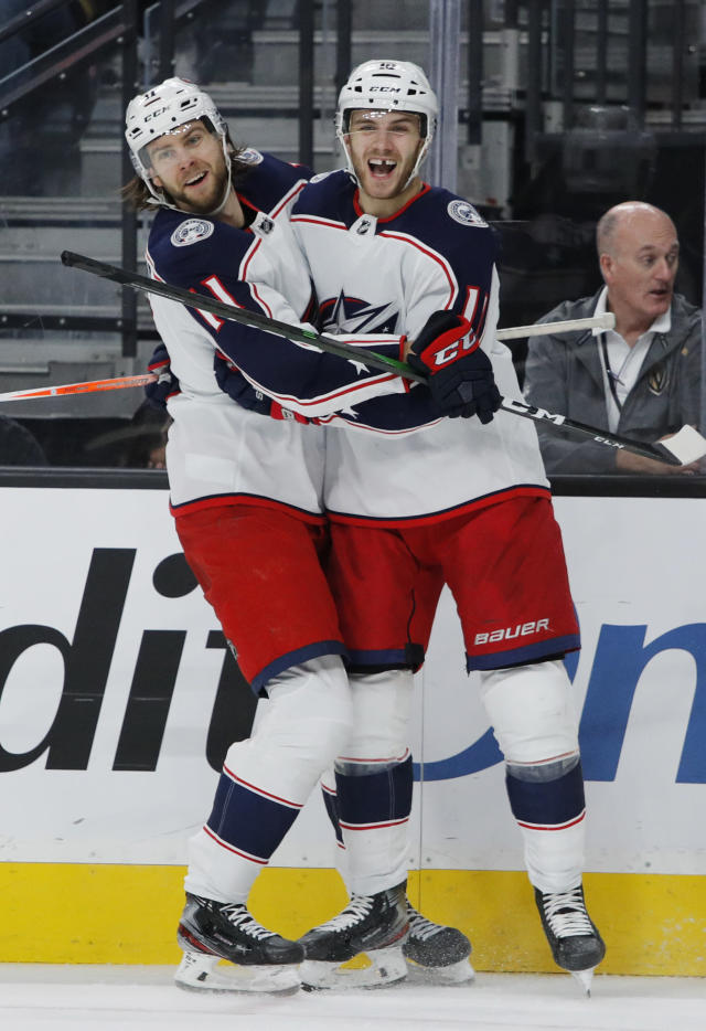 Columbus Blue Jackets' Kevin Stenlund, left, celebrates with Alexander Wennberg, right, who scored against the Vegas Golden Knights during the third period of an NHL hockey game Saturday, Jan. 11, 2020, in Las Vegas. (AP Photo/John Locher)