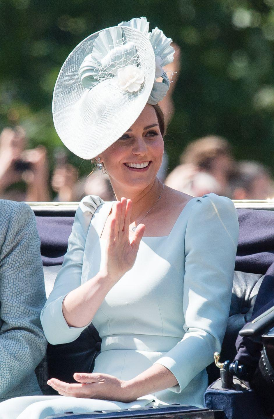 """<p>The Duchess looked lovely <a href=""""https://www.townandcountrymag.com/society/tradition/a21240655/kate-middleton-dress-trooping-the-colour-2018/"""" rel=""""nofollow noopener"""" target=""""_blank"""" data-ylk=""""slk:in a pale blue dress by Alexander McQueen"""" class=""""link rapid-noclick-resp"""">in a pale blue dress by Alexander McQueen</a> while attending the Queen's Trooping the Colour parade in London. She also wore a hat by Juliette Botterill for the festive occasion. </p>"""