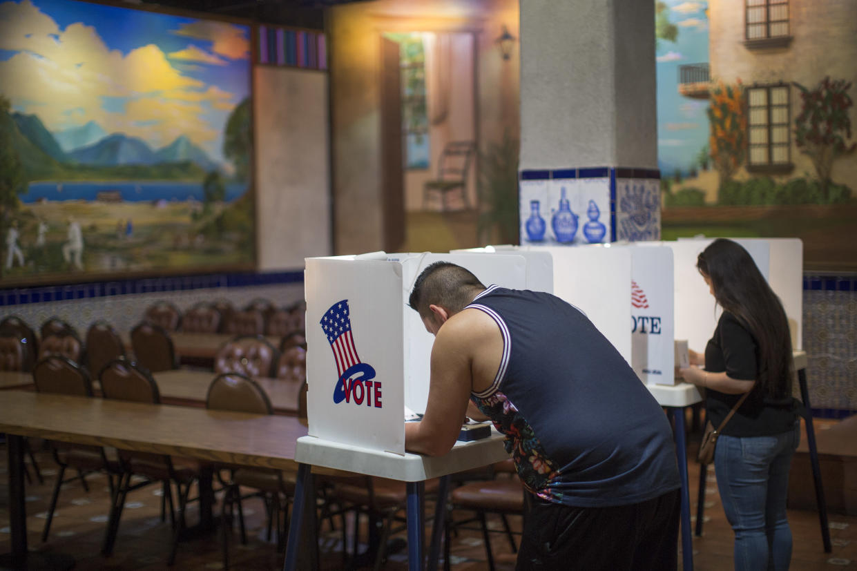 Latinos vote at a polling station in El Gallo Restaurant on Nov. 8, 2016, in the Boyle Heights section of Los Angeles. (Photo: David McNew/Getty Images)