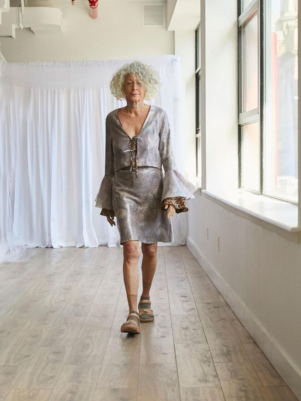 <p>Older female model wears a bell sleeve dress at the Collina Strada Fall/Winter 2018 show. (Photo: Jonathan Hokklo) </p>