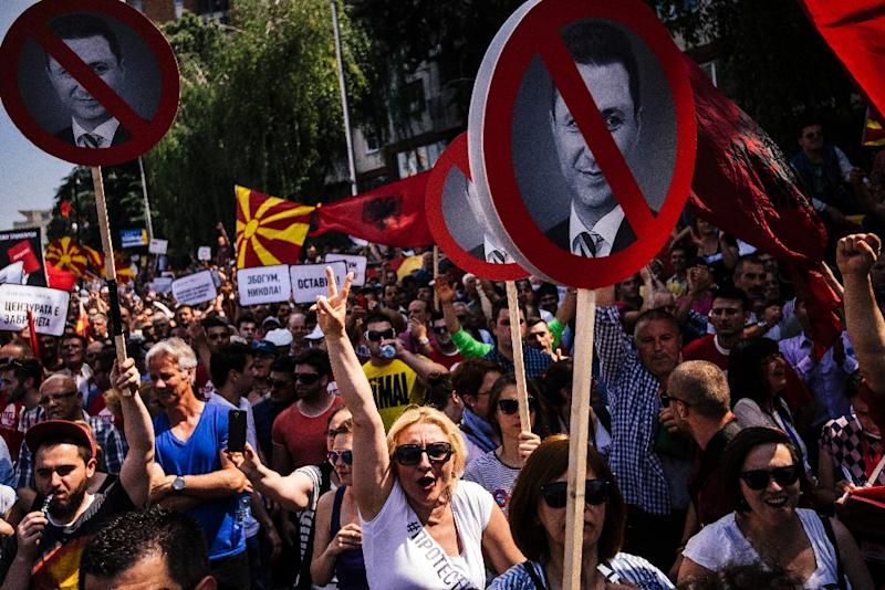 People hold signs with a picture of Macedonian Prime Minister Nikola Gruevski during an anti-government protest in downtown Skopje on May 17, 2015 (AFP Photo/Dimitar Dilkoff)