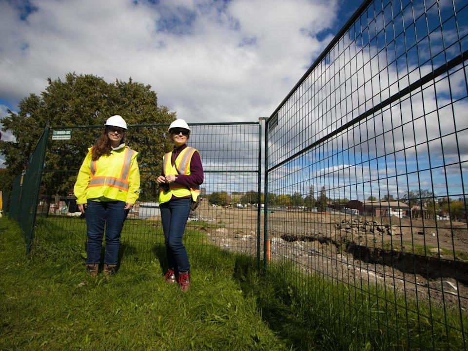 Erin Tait, left, the City of Ottawa's environmental remediation specialist, and Louise Cerveny, right, planner and project manager for the parks and facilities planning department, stand next to Laroche Park. (Trevor Pritchard/CBC - image credit)