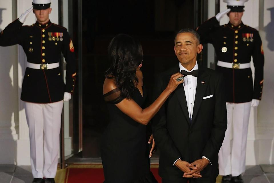 <p>When she still fusses with his bow tie 11 years later. [Photo: Getty/Chip Somodevilla}</p>