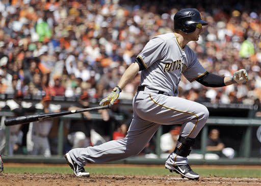 Pittsburgh Pirates' Alex Presley swings for an RBI single off San Francisco Giants' Ryan Vogelsong during the second inning of a baseball game Sunday, April 15, 2012, in San Francisco. (AP Photo/Ben Margot)