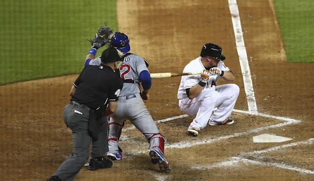 Miami Marlins batter Casey McGehee (9) ducks a high inside pitch that Chicage Cubs catcher Eli Whiteside (32) catches as home plate umpire Jeff Nelson watches during the fifth inning of a baseball game in Miami, Tuesday, June 17, 2014. (AP Photo/J Pat Carter)