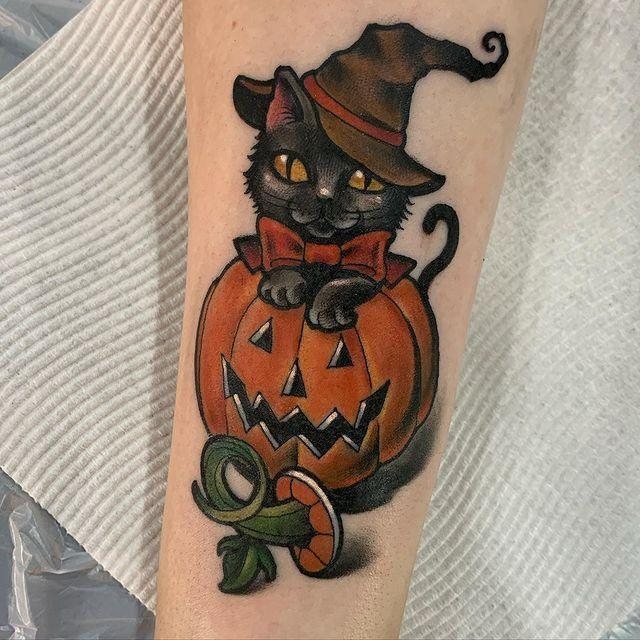"<p>Black cats may be considered bad luck by some, but this tattoo gives the kitty a little redemption. It's such a cute cat sitting in a pumpkin. Hats off to artist <a href=""https://www.instagram.com/sophielewistattoos/?utm_source=ig_embed"" rel=""nofollow noopener"" target=""_blank"" data-ylk=""slk:Sophie Lewis"" class=""link rapid-noclick-resp"">Sophie Lewis</a> for this one.</p><p><a href=""https://www.instagram.com/p/CCNWQWxHDJc/?utm_source=ig_embed&utm_campaign=loading"" rel=""nofollow noopener"" target=""_blank"" data-ylk=""slk:See the original post on Instagram"" class=""link rapid-noclick-resp"">See the original post on Instagram</a></p>"