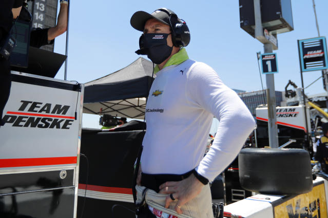 Driver Simon Pagenaud stands on pit road as work is done to his vehicle during a practice for the IndyCar auto race at Texas Motor Speedway in Fort Worth, Texas, Saturday, June 6, 2020. (AP Photo/Tony Gutierrez)