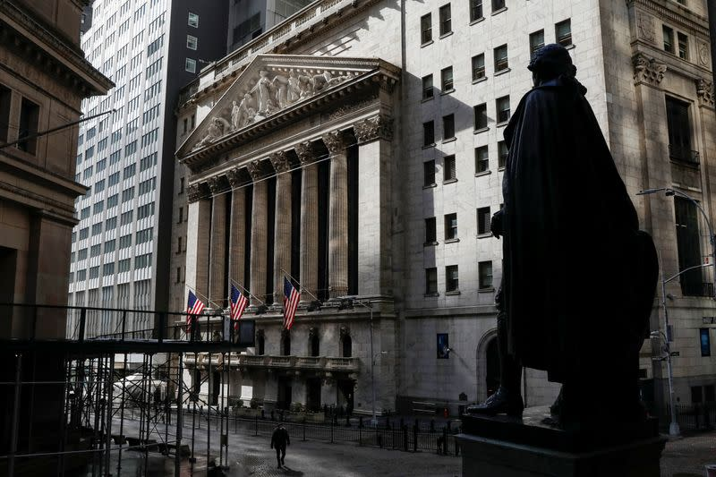 A statue of George Washington is seen on Wall St. across from the NYSE is seen in New York