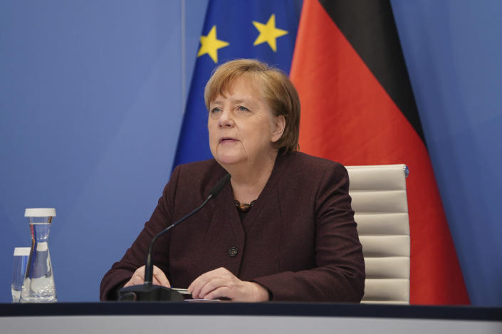 German Chancellor Angela Merkel speaks at the Chancellery in Berlin, Germany, Tuesday, Jan. 26, 2021 during an online conference at the Davos Agenda. The Davos Agenda from Jan. 25 to Jan. 29, 2021 is an online edition due to the coronavirus disease (COVID-19) outbreak. The global effort in the fight against the coronavirus pandemic is among the major topics facing the Davos forum this year. (Sean Gallup/Pool Photo via AP)