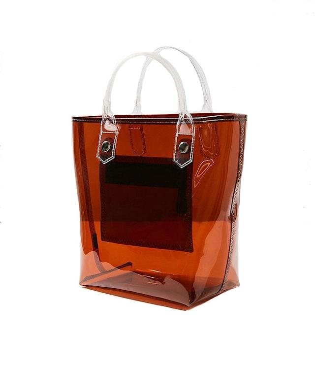 "<p>Clear Mini Tote Bag, $24, <a href=""https://www.urbanoutfitters.com/shop/clear-mini-tote-bag?category=bags-wallets-for-women&color=020&quantity=1&size=ONE%20SIZE&type=REGULAR"" rel=""nofollow noopener"" target=""_blank"" data-ylk=""slk:urbanoutfitters.com"" class=""link rapid-noclick-resp"">urbanoutfitters.com</a> </p>"