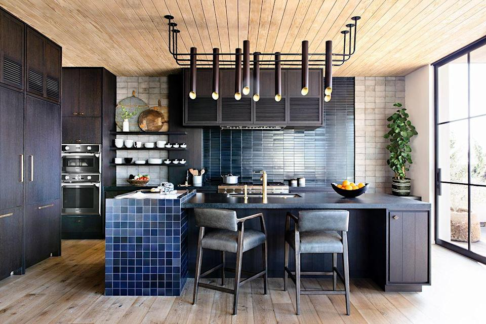 "<p>This <a href=""http://www.ericolsendesign.com/"" rel=""nofollow noopener"" target=""_blank"" data-ylk=""slk:Eric Olsen"" class=""link rapid-noclick-resp"">Eric Olsen</a> kitchen has serious tile game. If you live by the coast but want something moodier or you simply love blue, take not from the rich navy, gray, and cobalt tones throughout.</p>"