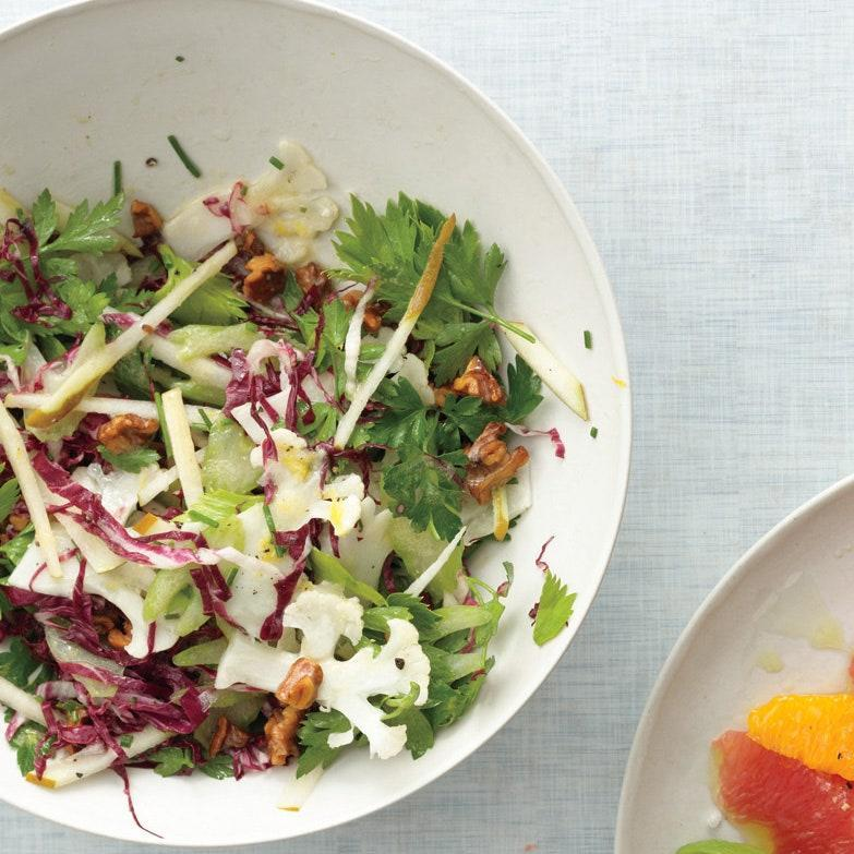 """Walnut oil gives this salad dressing extra-rich nuttiness which complements the crisp raw shaved veggies and mellow, juicy pears. <a href=""""https://www.epicurious.com/recipes/food/views/shaved-cauliflower-and-radicchio-salad-388668?mbid=synd_yahoo_rss"""" rel=""""nofollow noopener"""" target=""""_blank"""" data-ylk=""""slk:See recipe."""" class=""""link rapid-noclick-resp"""">See recipe.</a>"""