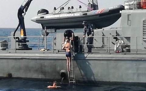 She climbed the ladder to board the Croatian Coast Guard ship Cavtat herself, after spending ten hours in the sea