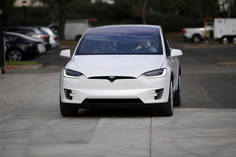 The Tesla Model X car is test driven at the company's headquarters Tuesday, Sept. 29, 2015, in Fremont, Calif. Tesla's Model X — one of the only all-electric SUVs on the market — was officially unveiled Tuesday night near the company's California factory. (AP Photo/Marcio Jose Sanchez)