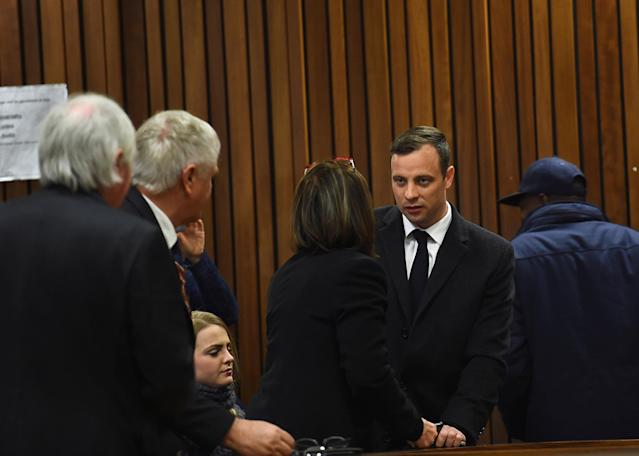 Olympic and Paralympic track star Oscar Pistorius speaks with his legal team ahead of his sentence hearing at the North Gauteng High Court in Pretoria, South Africa, July 6, 2016. REUTERS/Masi Losi/Pool