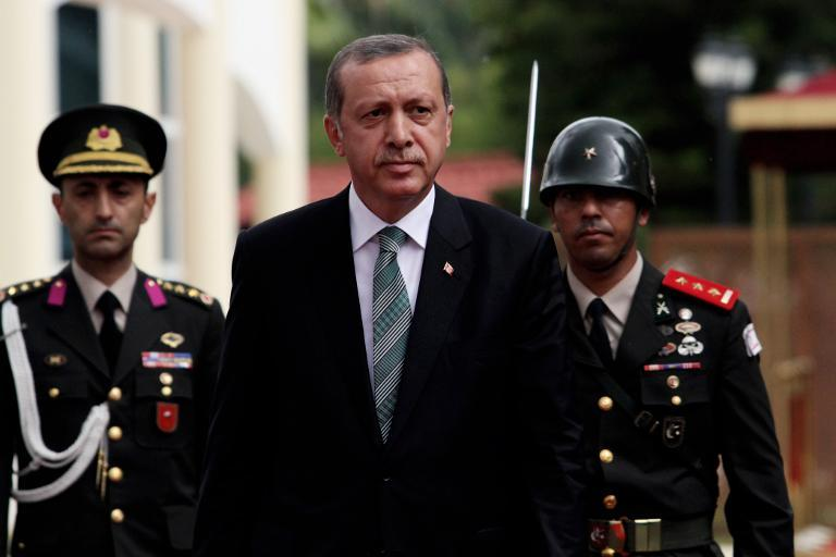 Turkish President Recep Tayyip Erdogan (C) walks past an hounor guard in the Turkish-occupied sector of Nicosia on September 1, 2014