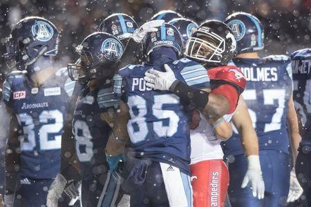 Nov 26, 2017; Ottawa, Ontario, CAN; A Calgary Stampeders player congratulates Toronto Argonauts wide receiver DeVier Posey (85) before the last play of the game at TD Place Stadium. The Argonauts defeated the Stampeders 27-24 to win the Grey Cup. Mandatory Credit: Marc DesRosiers-USA TODAY Sports