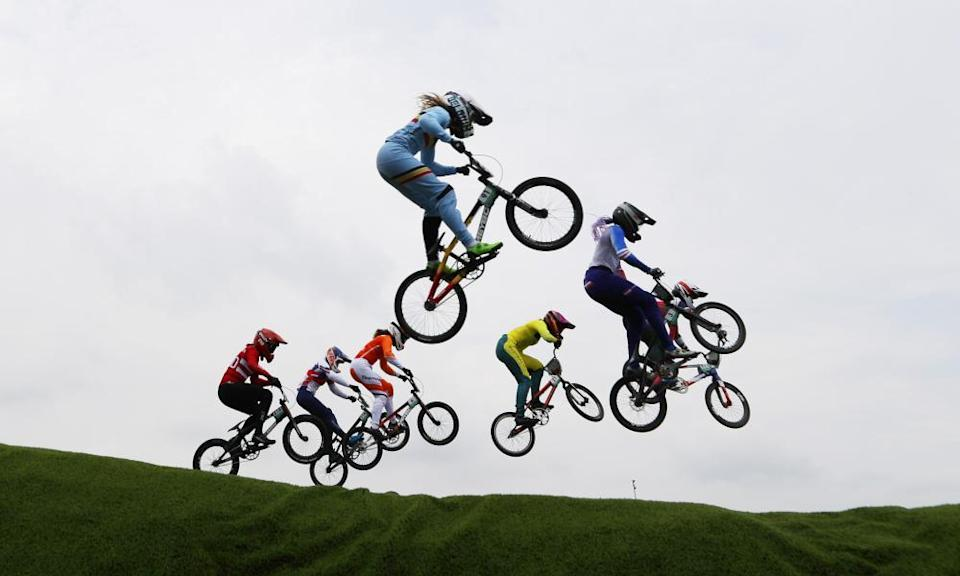 BMX bikers including eventual gold-medalist Bethany Shriever take a jump during one of the BMX semi-finals.