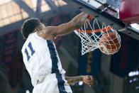 Penn State's Lamar Stevens dunks the ball during the first half of an NCAA college basketball game against Iowa Saturday, Jan. 4, 2020, in Philadelphia. (AP Photo/Chris Szagola)