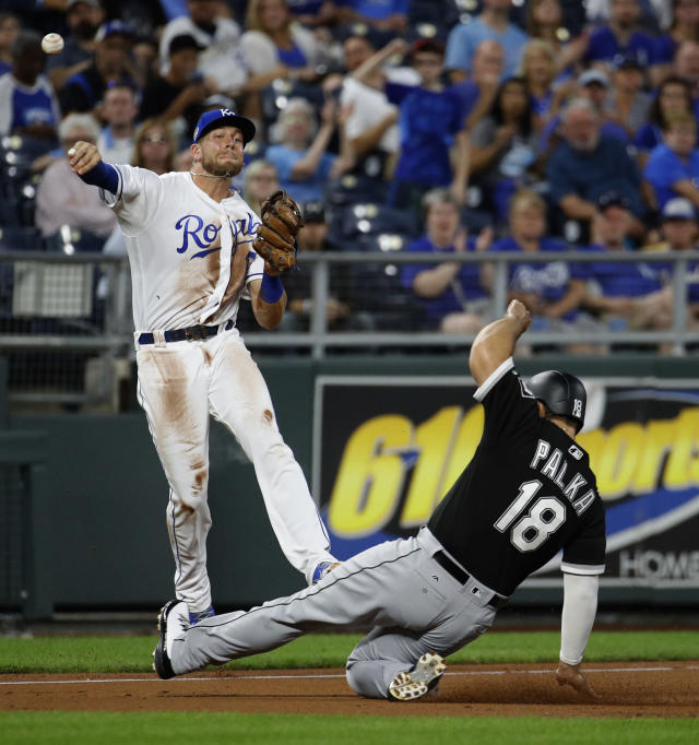 Kansas City Royals third baseman Hunter Dozier throws to first for the out on Chicago White Sox's Welington Castillo while Daniel Palka (18) advances to third during the second inning of a baseball game Tuesday, Sept. 11, 2018, in Kansas City, Mo. (AP Photo/Charlie Riedel)