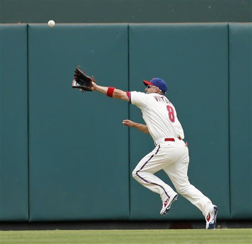 Philadelphia Phillies' Shane Victorino chases a double hit by San Francisco Giants' Melky Cabrera in the first inning of a baseball game on Sunday July 22, 2012, in Philadelphia. (AP Photo/H. Rumph Jr)