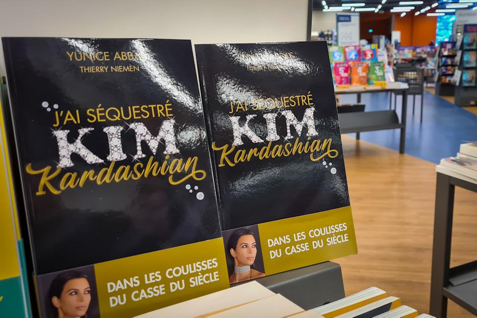 ORMESSON, FRANCE - FEBRUARY 04: Copies of the book 'J'ai Séquestré Kim Kardashian' written by thief who robbed Kim Kardashian in Paris at gunpoint in 2016 are displayed in a bookstore on February 04, 2021 in Ormesson, France. Yunice Abbas is one of five men who robbed Kim Kardashian in Paris in 2016 and reveals the details of the heist in a new book published today. (Photo by Marc Piasecki/Getty Images)