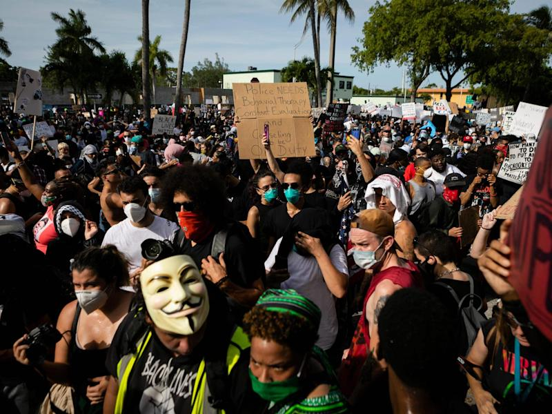 Protesters gather at Fort Lauderdale Police Department during a rally in response to the recent death of George Floyd: (AFP)
