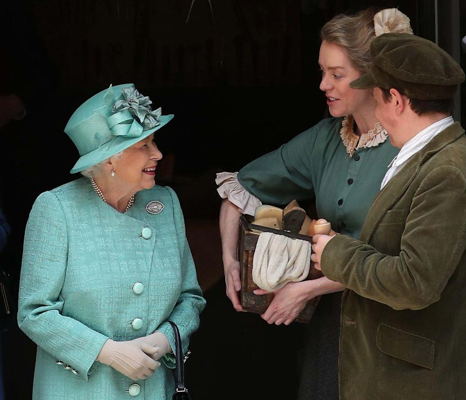 <p>Queen Elizabeth visits the replica Sainsbury's, where she was introduced to self checkout for the very first time.</p>