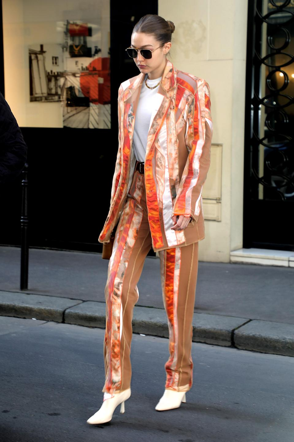 Suit but make it fun. Gigi visited the Chanel headquarters in Paris clad in this showstopping suit.