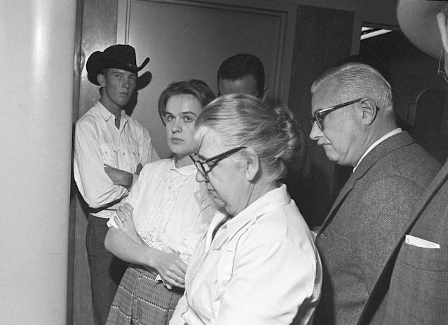 <p>Marina Oswald is shown with her mother-in-law, Marguerite Claverie Oswald, in the police station in Dallas where her husband, Lee Harvey Oswald is accused in the assassination of President John F. Kennedy, Nov. 22, 1963. Men are unidentified. (Photo: AP) </p>