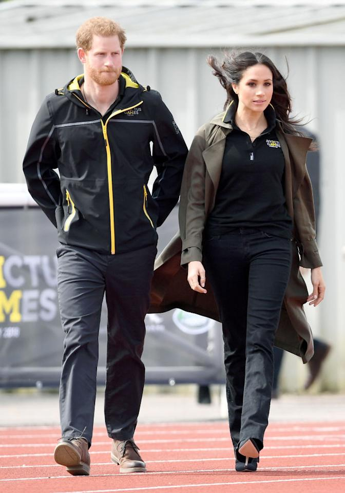 <p>For the UK team trials ahead of the Invictus Games, Meghan Markle recycled her go-to jeans by Mother Denim. She finished the look with an official polo and a spring-ready trench by Babaton for Aritizia. <em>[Photo: Getty]</em> </p>