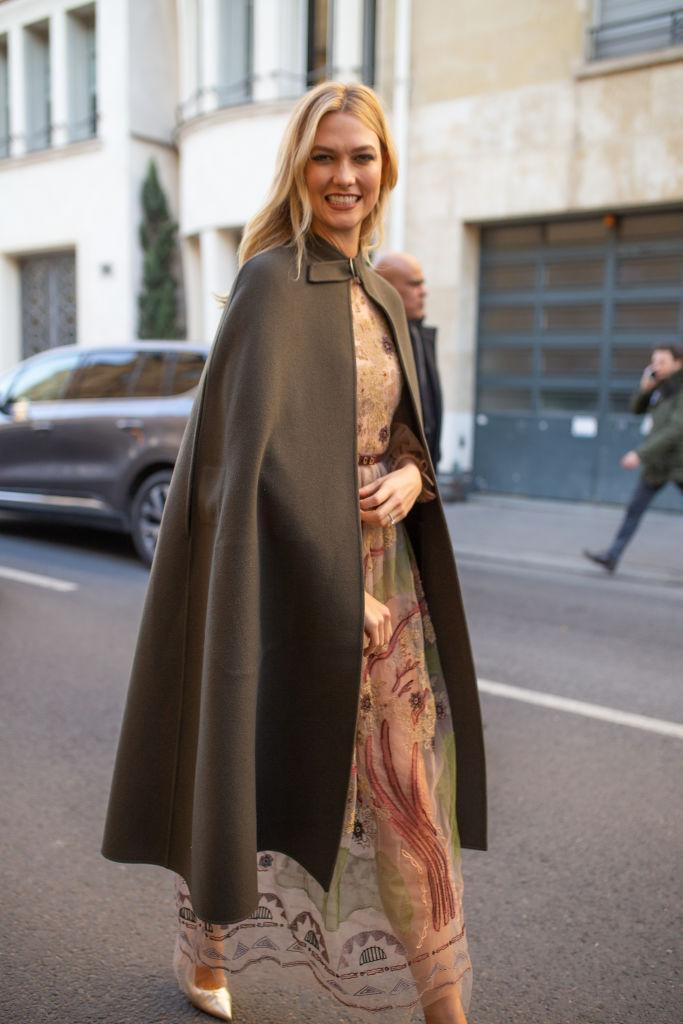 Karlie Kloss is seen on the street attending CHRISTIAN DIOR during Paris Haute Couture Fashion Week wearing Dior outfit with hunter green cloak on January 21, 2019 in Paris, France. (Photo by Matthew Sperzel/Getty Images)
