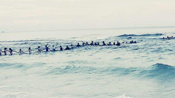 PHOTO: A group of strangers linked arms and waded into the ocean to rescue a group of swimmers stranded off the coast of Panama City Beach, Fla. (Rosalind Beckton)