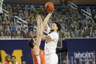 Michigan forward Brandon Johns Jr. (23) shoots on Illinois forward Giorgi Bezhanishvili (15) in the second half of an NCAA college basketball game in Ann Arbor, Mich., Tuesday, March 2, 2021. (AP Photo/Paul Sancya)