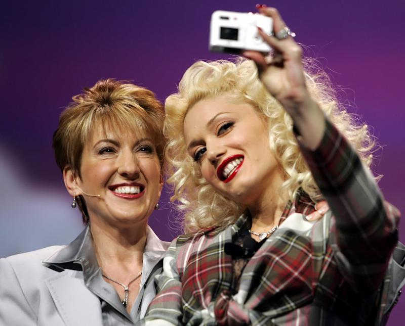 Fiorina has her picture taken with singer Gwen Stefani at the 2005 International Consumer Electronics Show in Las Vegas, January 7, 2005. REUTERS/Mike Blake