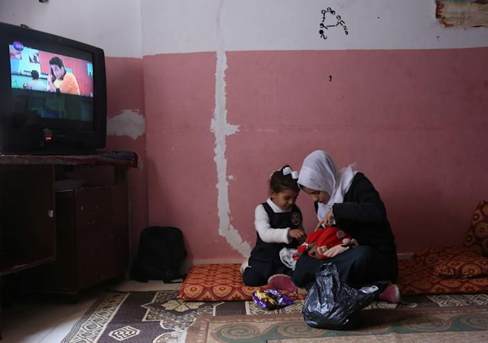 Palestinian high school student Wessal Abu Amra, 17, seen playing with her sister in their house in Gaza City in February. (Photo: Samar Abo Elouf/Reuters)