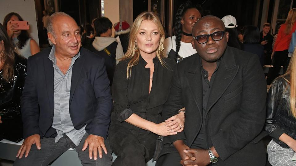 Arcadia Group chairman Sir Philip Green, Kate Moss and Edward Enninful sit by the catwalk.