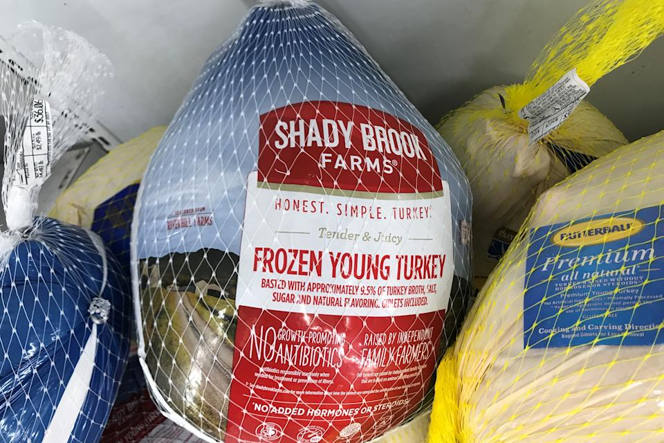 Frozen turkeys are pictured in a freezer case during the coronavirus pandemic in the Manhattan borough of New York City, New York, U.S., November 19, 2020. REUTERS/Carlo Allegri