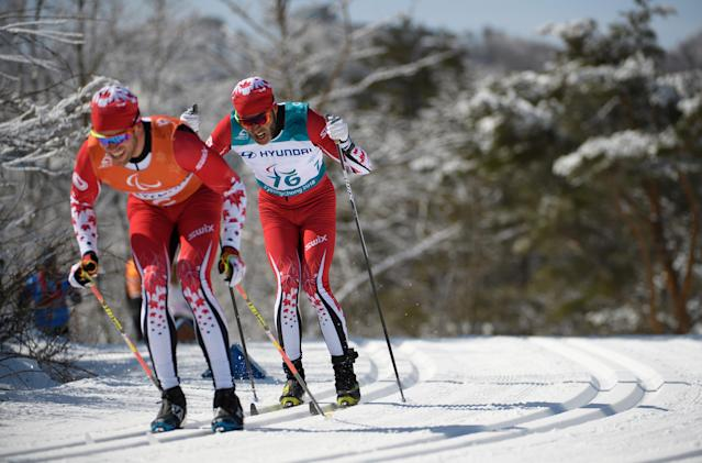 Brian Mckeever of Canada and his guide Graham Nishikawa competes during the Cross Country Skiing Men's Visually Impaired 10km Classic at the Alpensia Biathlon Centre. The Paralympic Winter Games, PyeongChang, South Korea, Saturday 17th March 2018. OIS/IOC/Thomas Lovelock/Handout via Reuters