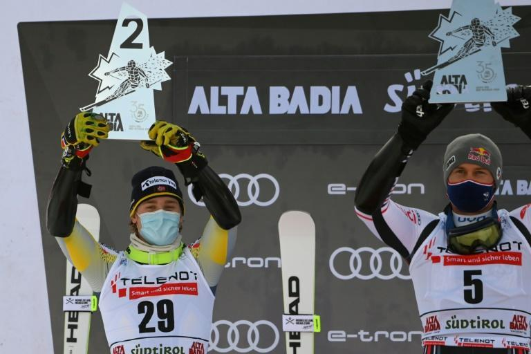 Runner-up McGrath (L) and race winner Pinturault (R) celebrate on the podium