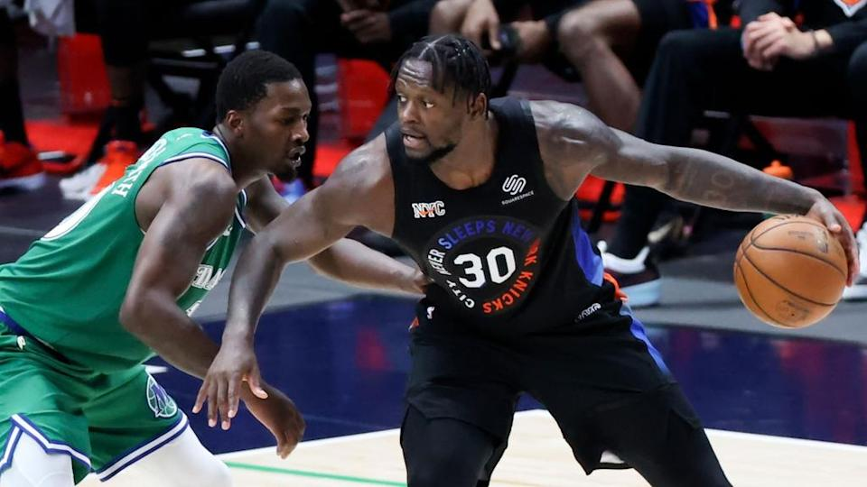 Apr 16, 2021; Dallas, Texas, USA; New York Knicks forward Julius Randle (30) dribbles as Dallas Mavericks forward Dorian Finney-Smith (10) defends during the second quarter at American Airlines Center.
