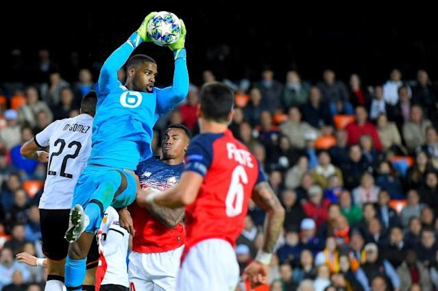 Lille goalkeeper Mike Maignan comes out to collect the ball during his team's Champions League defeat by Valencia recently (AFP Photo/JOSE JORDAN )