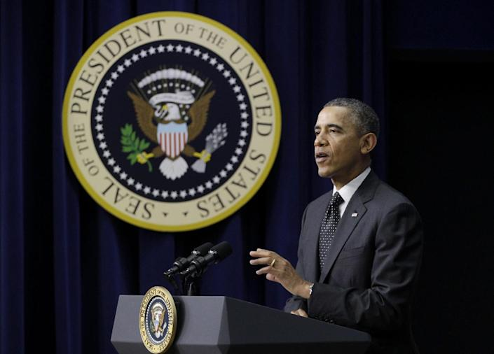 President Barack Obama gestures as he speaks at the Connected Educator Champions of Change event, Thursday, Nov. 21, 2013, in the Eisenhower Executive Office Building on teh White House campus in Washington. (AP Photo/Carolyn Kaster)