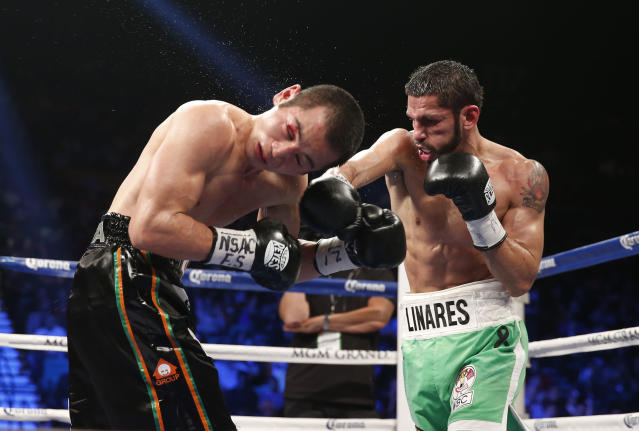 Jorge Linares of Barinas, Venezuela, right, trades punches with Nihito Arakawa of Musashino, Japan during their lightweight boxing match, Saturday, March 8, 2014, at The MGM Grand Garden Arena in Las Vegas. Linares won by unanimous decision. (AP Photo/Eric Jamison)