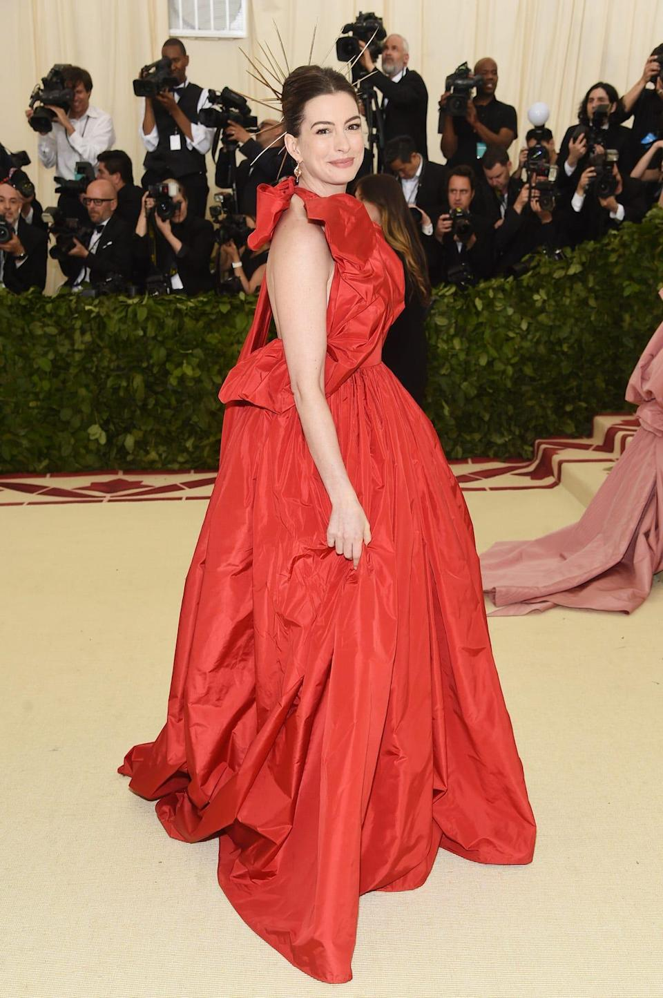 Anne Hathaway attends the Met Gala 2018