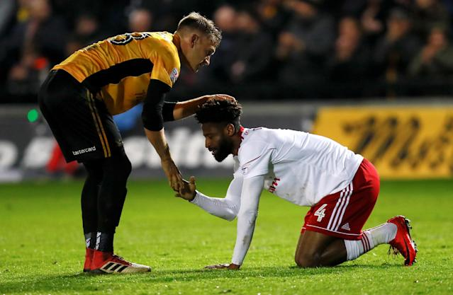 "Soccer Football - League Two - Newport County AFC v Accrington Stanley - Rodney Parade, Newport, Britain - April 24, 2018 Accrington Stanley's Janoi Donacien and Newport County's Mickey Demetriou at full time Action Images/Jason Cairnduff EDITORIAL USE ONLY. No use with unauthorized audio, video, data, fixture lists, club/league logos or ""live"" services. Online in-match use limited to 75 images, no video emulation. No use in betting, games or single club/league/player publications. Please contact your account representative for further details."