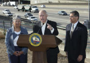 FILE - In this Oct. 26, 2018, file photo, California Gov. Jerry Brown, center, stands between California Air Resources Board Chair Mary Nichols and Attorney General Xavier Becerra in Sacramento, Calif. Nichols' term leading the California ARB ends in December 2020. She's held the role since 2007 after an earlier stint as chair in the early 1980s. (AP Photo/Rich Pedroncelli, File)