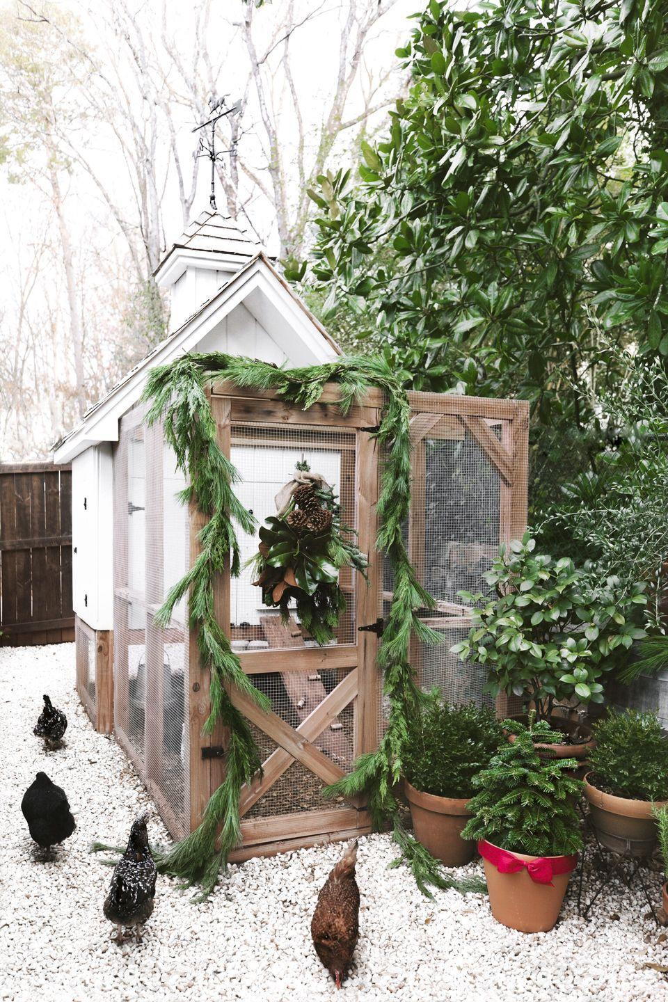 """<p>Don't forget your feathered friends when decorating your windows (and doors!). Here a simple fir garland flanks the door, while a magnolia leaf wreath graces the window. </p><p><a class=""""link rapid-noclick-resp"""" href=""""https://www.amazon.com/artificial-Magnolia-leaves-pack-30/dp/B074CSY3PF/?tag=syn-yahoo-20&ascsubtag=%5Bartid%7C10050.g.23343056%5Bsrc%7Cyahoo-us"""" rel=""""nofollow noopener"""" target=""""_blank"""" data-ylk=""""slk:SHOP MAGNOLIA LEAVES"""">SHOP MAGNOLIA LEAVES</a></p>"""