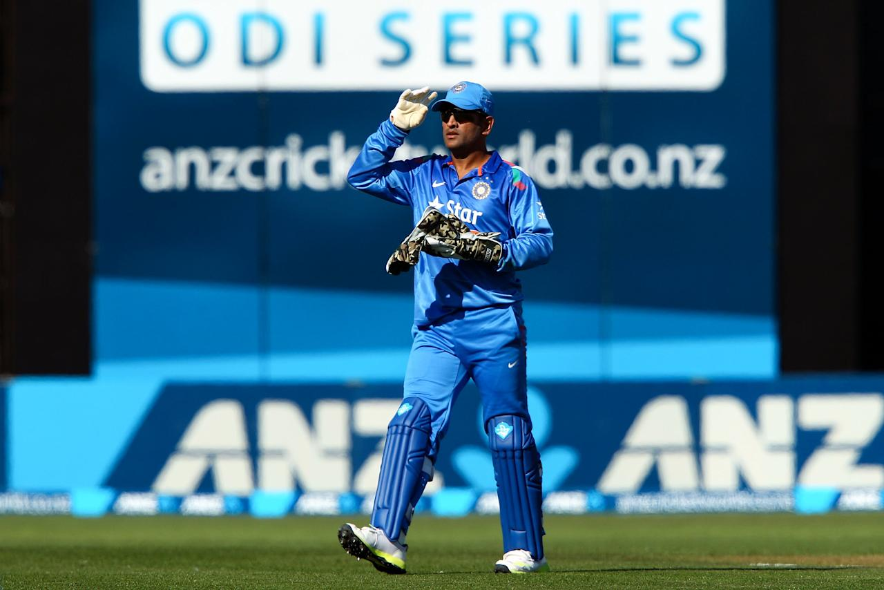 NAPIER, NEW ZEALAND - JANUARY 19:  MS Dhoni of India leaves the field at the end of the New Zealand innings during the first One Day International match between New Zealand and India at McLean Park on January 19, 2014 in Napier, New Zealand.  (Photo by Hagen Hopkins/Getty Images)