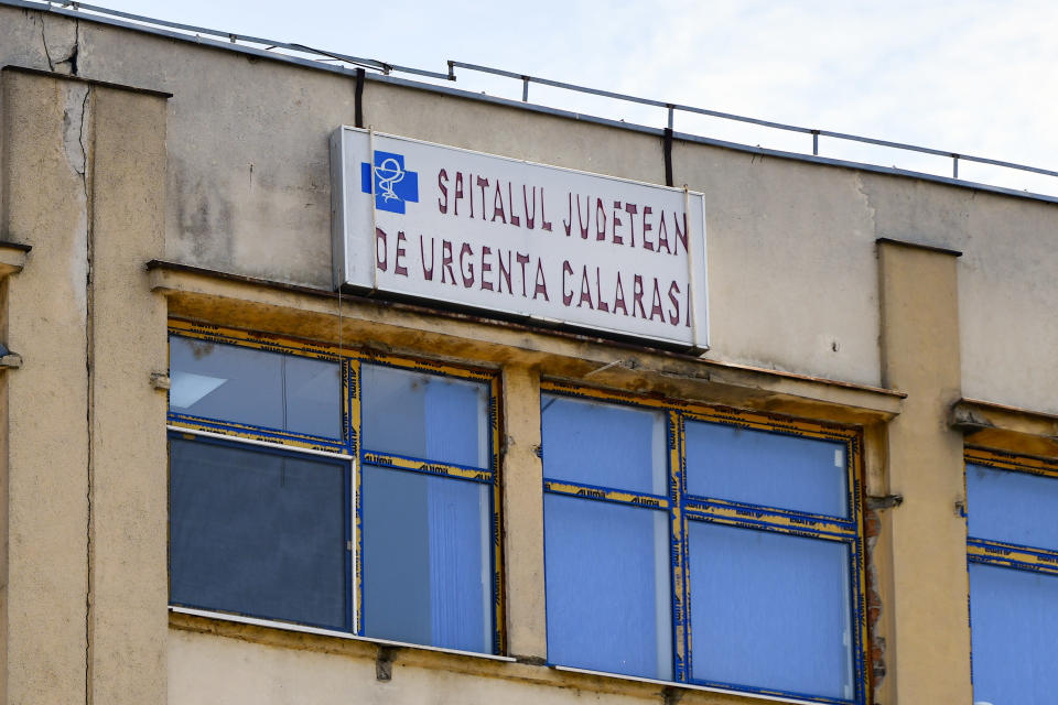 An old sign hangs on the top floor of the Emergency Hospital in Calarasi, southern Romania, the former workplace of Claudia Anghel, a Romanian midwife working in England, on Monday, July, 27, 2020. Romania joined the European Union in 2007 and, by 2013, more than 14,000 Romanian doctors were working abroad, about 26% of the country's total number of physicians. (AP Photo/Andreea Alexandru)